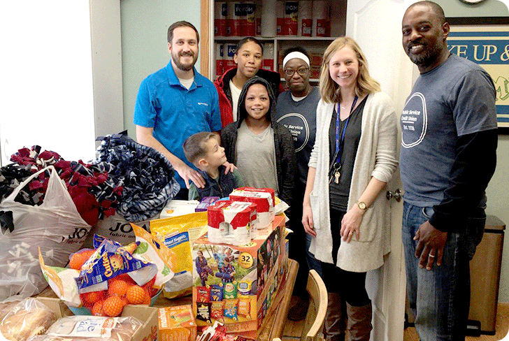 The Canvas Community Involvement team drops off goods at a local food pantry.
